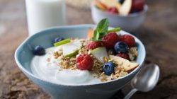 Bowl with yogurt, fresh fruit and oats