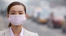 Chinese businesswoman wearing surgical mask haze pollution