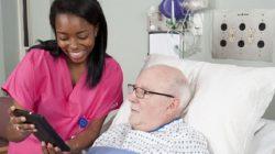 Nurse on iPad with Elderly Man